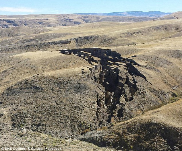 "Gaping: A gigantic opening was spotted in the Big Horn Mountains in Wyoming this month. SNS Outfitter & Guides said 'Everyone here is calling it ""the gash"". It's a really incredible sight'"