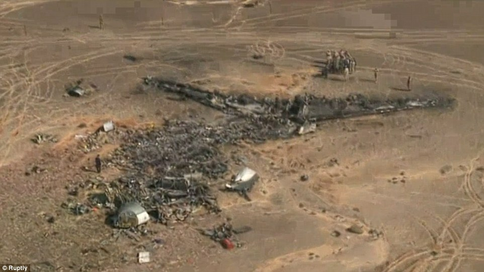 The jet, carrying 224 passengers and crew disappeared from radar screens 23 minutes after it left Sharm el-Sheikh, en-route to St Petersburg. Pictured: Debris from the Airbus can be seen scattered across a large swathe of remote Egyptian farmland after the crash