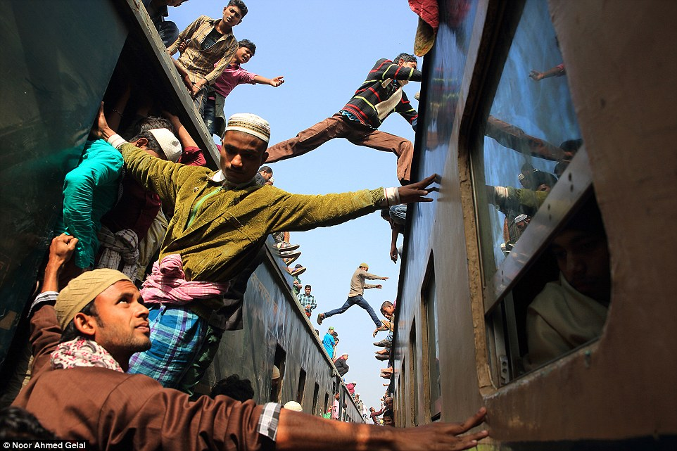 Travel winner: Jumping over the train, Gazipur, Bangladesh, by Noor Ahmed Gelal. 'At the end of the annual Biswa Iztema, the second-largest Muslim gathering in Bangladesh, a lot of people are rushing to try to grab in any possible way a seat or a space on a train at Tongi railway station'
