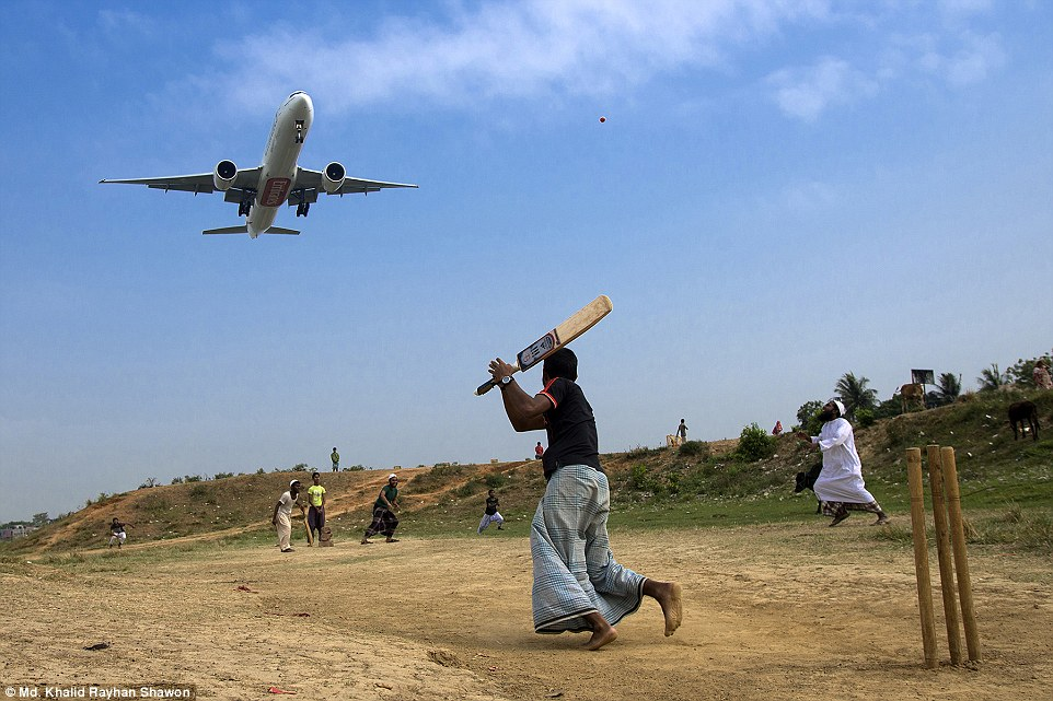 Travel - Honourable mention: Runway Cricket byMd. Khalid RayhanShawon.Local boys near runway playing cricket under the flying path of an aircraft of the airport
