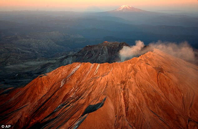 The scarred and jagged crater of Mount St Helen's (pictured) looms over the surrounding countryside in Washington. Its current shape is the result of a massive explosion in 1980, but a lava dome has been steadily growing inside the crater since 2004
