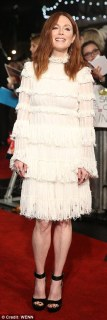 Daring to be different: Julianne Moore sported a white tiered dress to walk the red carpet at The Hunger Games: Mockingjay - part 2 UK premiere in London's Leicester Square on Thursday evening