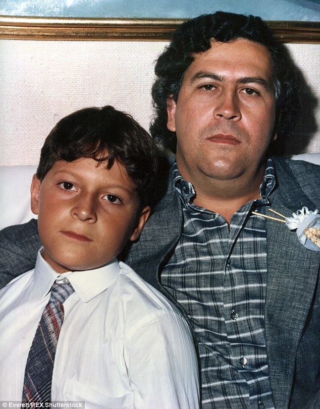 Escobar, right, was one of the world's biggest drug dealers, pictured with his son Sebastian, left