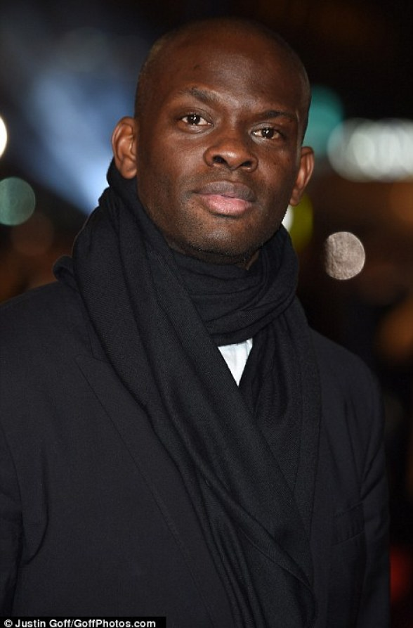 Ronaldo's former United team-mate Louis Saha wore a black scarf at the premiere