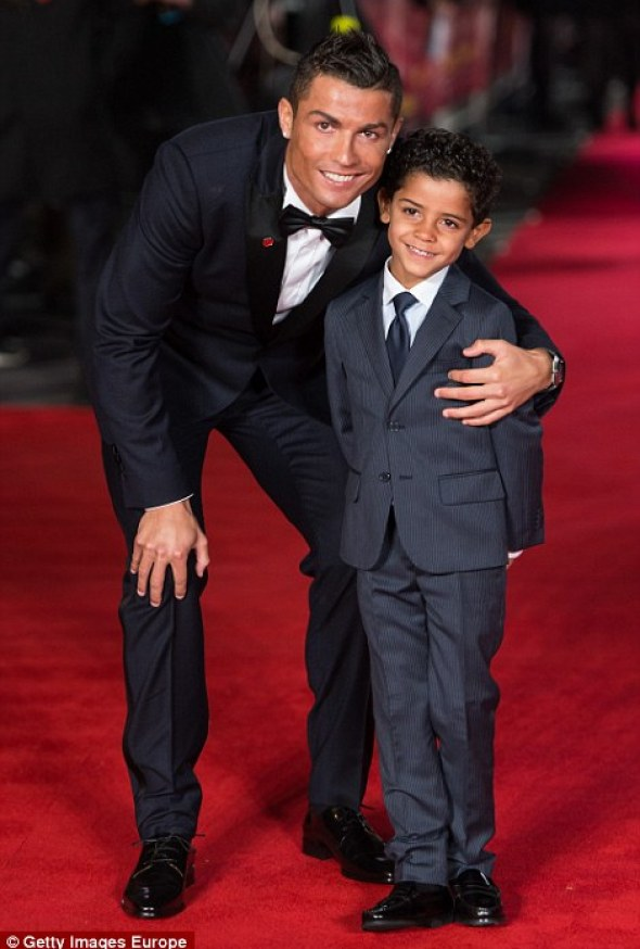 Cristiano Ronaldo Jr looked delighted to be with his famous father
