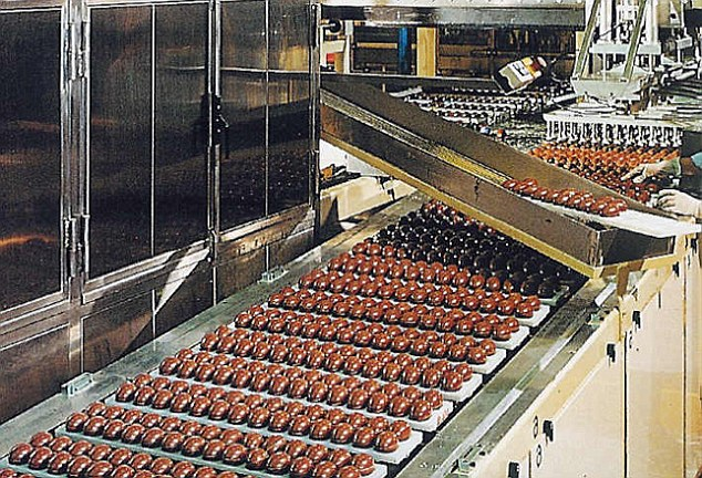 Production line: Michele invented Kinder Surprise (pictured in the 1970s) because decided that children should experience the excitement that they get from Easter every day