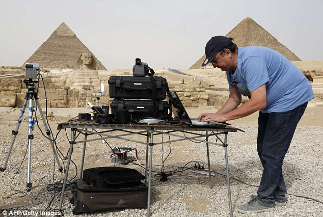 The hi-tech technique could mark a new era of discoveries. Here, an engineer sets up the infrared thermography equipment which is being used to map the temperature of the walls of the Giza pyramids