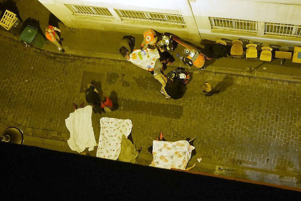 Bodies litter the streets of a Paris alley after a string of terror attacks in the French capital tonight