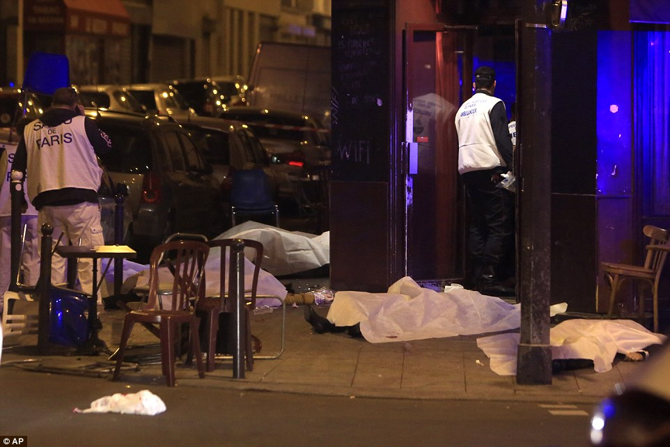 At least 127 people have been killed in a series of coordinated terror attacks in the heart of Paris which have paralysed the French capital. Pictured: A restaurant on Rue Bichat where several people were shot dead last night