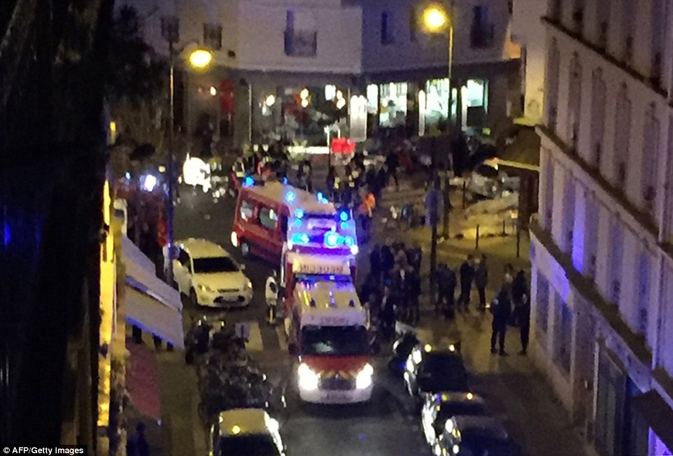 The horror started with Kalashnikov-wielding fanatics attacking Cambodian restaurant Le Petit Cambodge in the Bastille area of the city at around 9pm. Pictured, emergency services at the scene