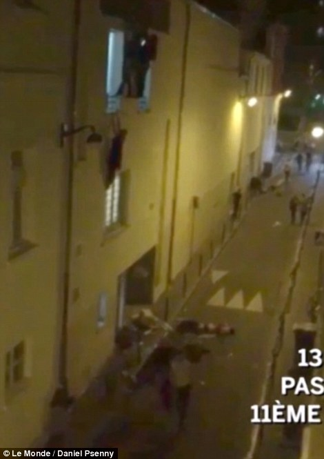 The footage shows a woman hanging from the second floor window of the Bataclan theatre, while others run for their lives into the street