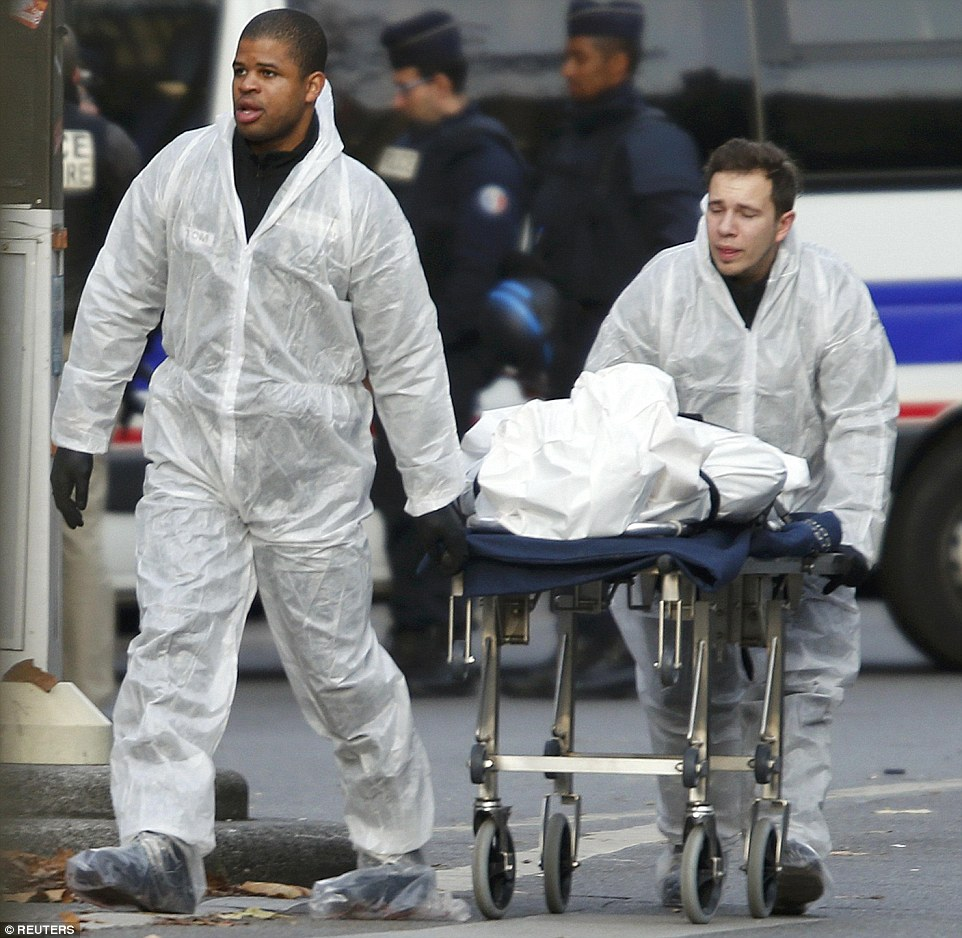 A victim is wheeled out of the Bataclan concert hallwhere Islamic State gunmen mercilessly slaughtered up to 100 fans before blowing themselves up in a series of co-ordinated attacks across the French capital