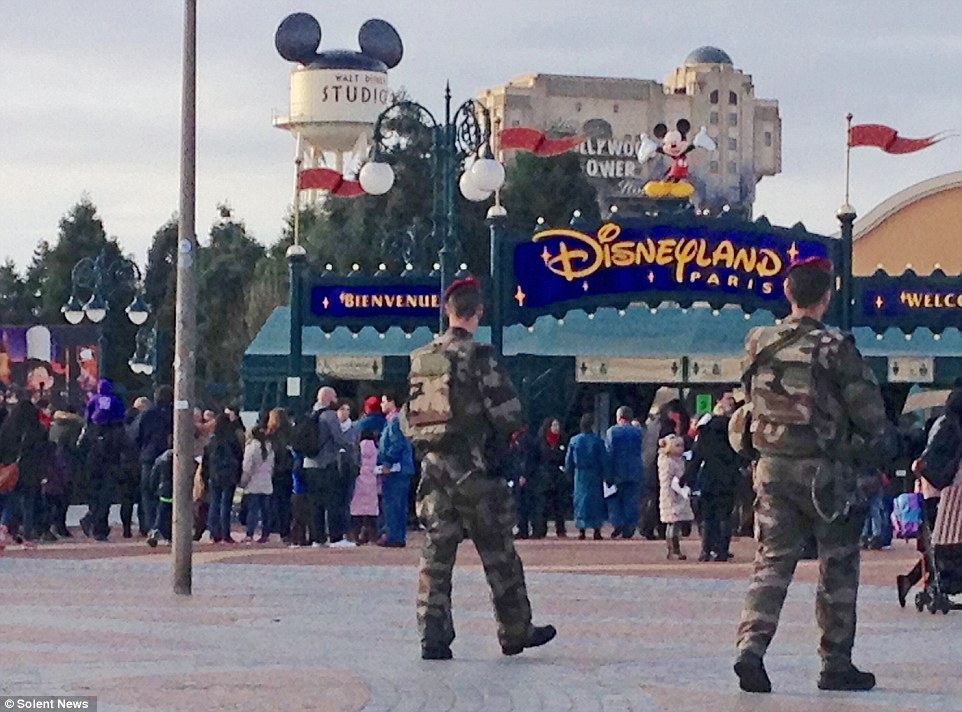 Soldiers were deployed at key sites around Paris, including Parliament buildings and religious sites, while in a highly unusual move Disneyland Paris has been closed to the public