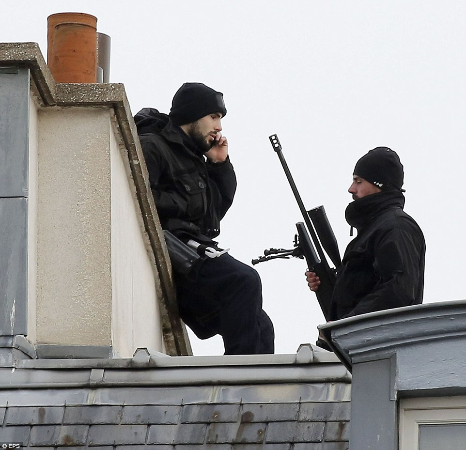 Snipers patrol the meeting at the Elysee Palace in Paris where President Francois Hollande was holding an emergency security meeting