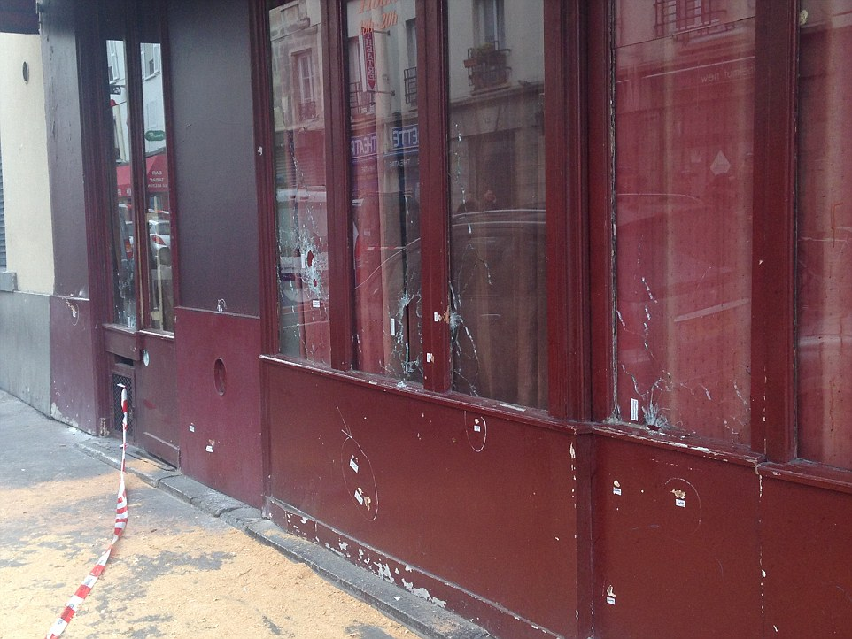 Windows at theCambodian restaurant Le Petit Cambodge are peppered with bullet holes after being targeted by ISIS fanatics