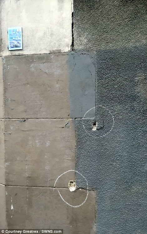 Bullets in the walls near to Le Petit Cambodge restaurant close to Rue Bichat, Paris, France