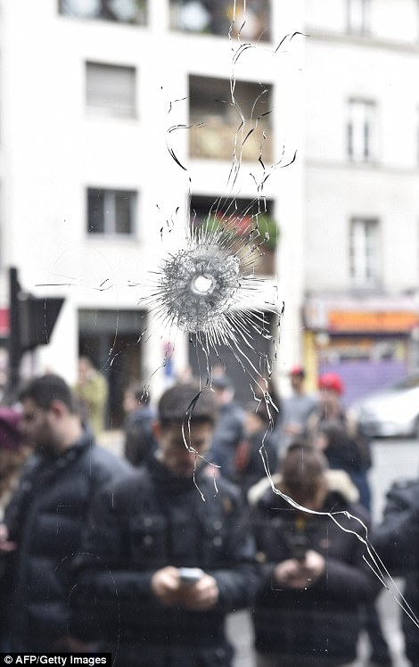 A bullet hole is seen in the window of a Japanese restaurant next to the cafe 'La Belle Equipe' at the Rue de Charonne in Paris