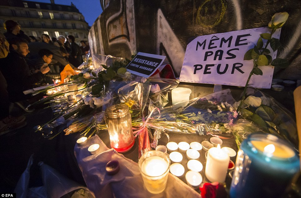 Thousands of people have taken to the streets of Paris to pay tribute to the victims of last nights' horrific attacks