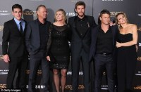 Liam Hemsworth joined by Luke and their parents at ...
