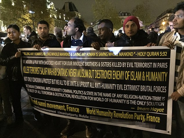 Speaking out: A group of around 30 French Muslims (pictured) joined mourners in the Place de la Republique to condemn the Paris terror attacks