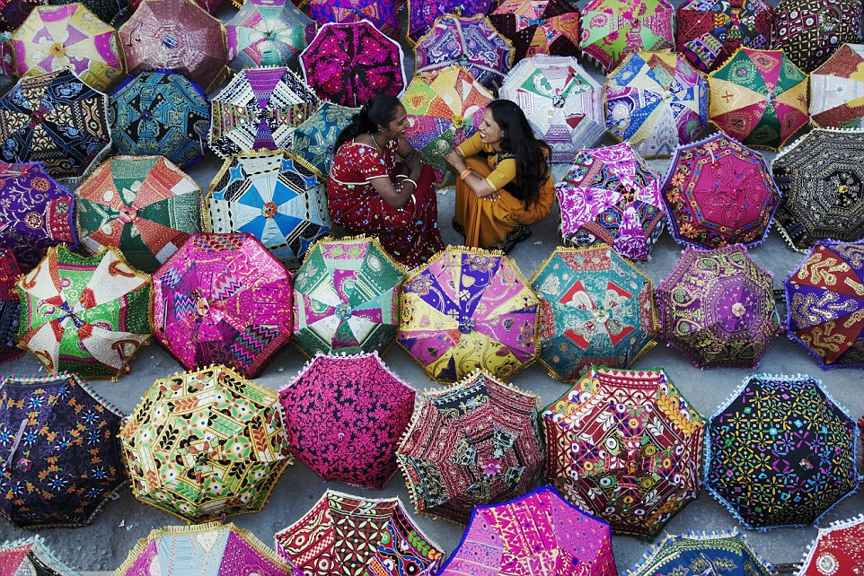 Colourful umbrellas (above) are set outside a shop inJaipur, north India, allowing shoppers to easily admire the products and browse