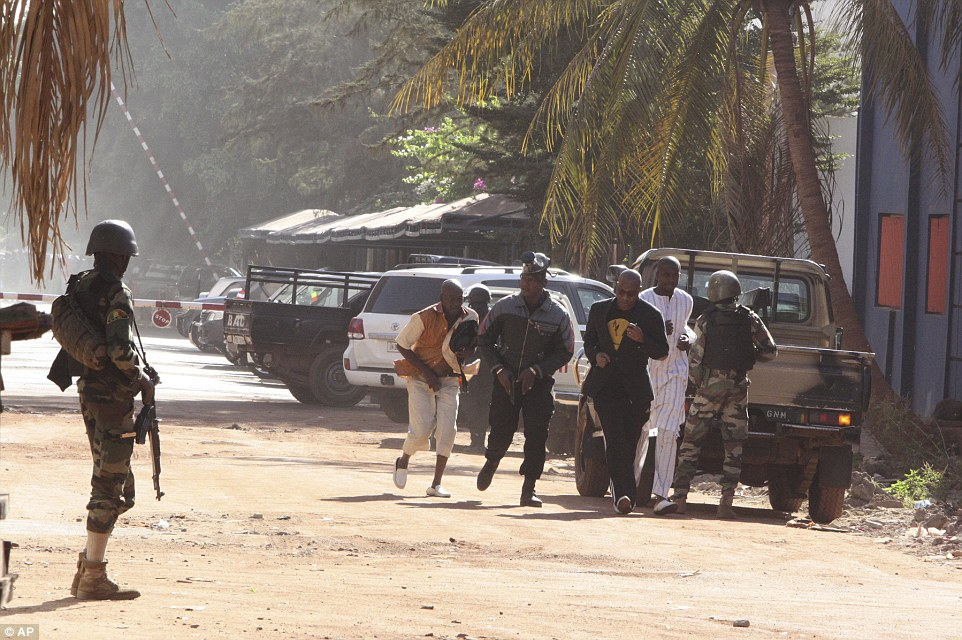 Terrified civilians run for their lives through the streets of Bamako after escaping the hotel siege