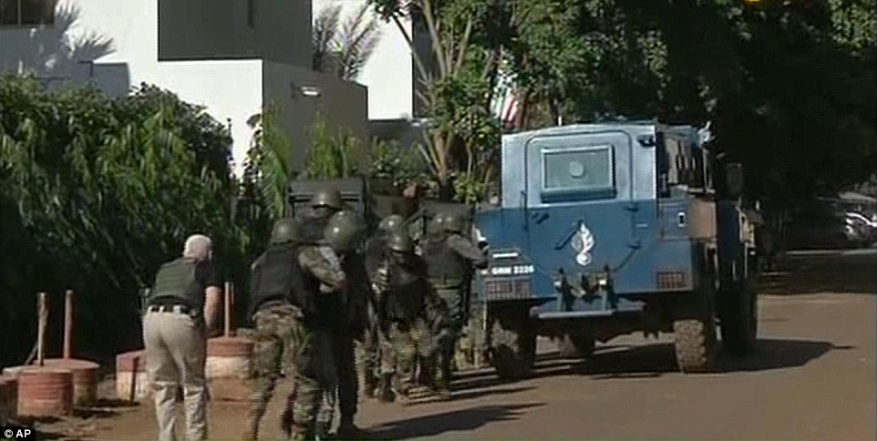 Malian special forces approach the back of the Radisson Blu Hotel in preparation to raid the building and take out the hostages