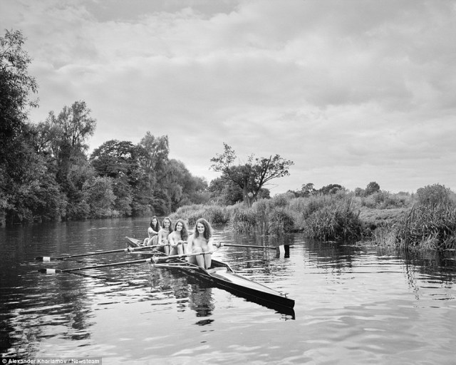 Here, four of the squad members row down the River Avon, in Barford, Warwickshire, in a boat during the nude photoshoot
