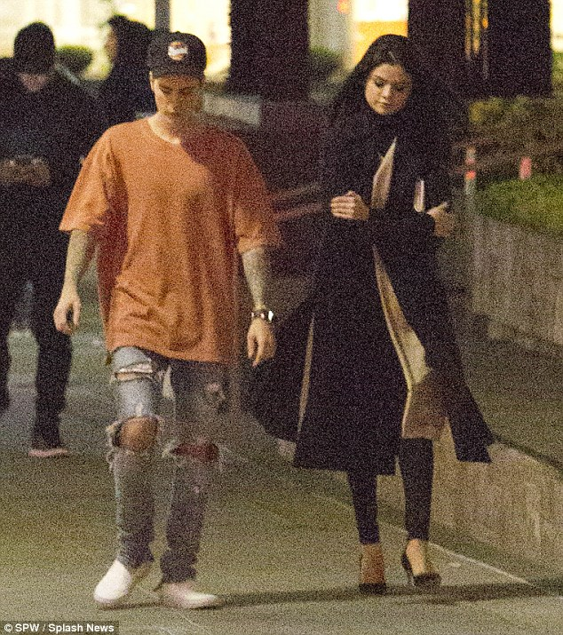 Getting on well: Clearly dressed to impress, Selena made visible effort for the outing - wearing a pair of skin-tight trousers, beige jumper dress and high-neck black shirt