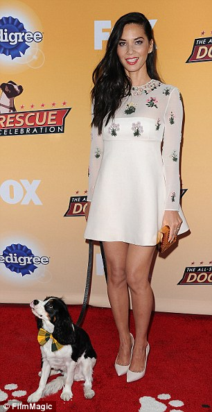 Pet friendly: Olivia Munn brought her cute pooch Chance to Saturday's All-Star Dog Rescue Celebration in Santa Monica, CA and Emmy Rossum cradled a furry friend too