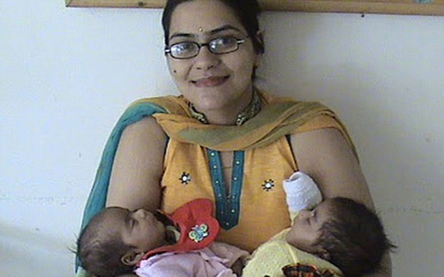 The 39-year-old paediatrician (pictured) refused to abort the twins and is now beginning a 'landmark' legal fight at India's high court