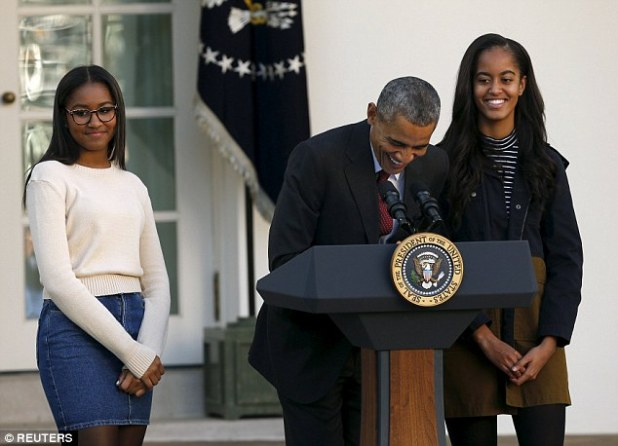 Waiting for a reaction: Sasha seemed to be checking how the audience was dealing with her father's jokes. Both she and Malia were wearing outfits from American Apparel.Sasha was in the store's crop top and high-waist denim skirt, while her sister wore a striped short sleeve top