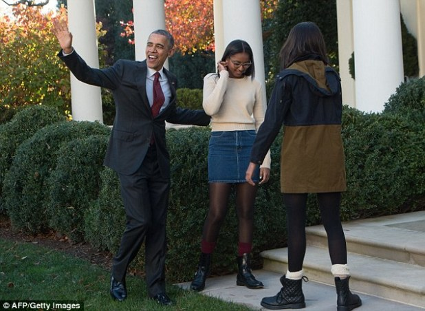 Acclaim: President Obama managed to get laughs from the auidence - and more importantly, and unusually, his daughters