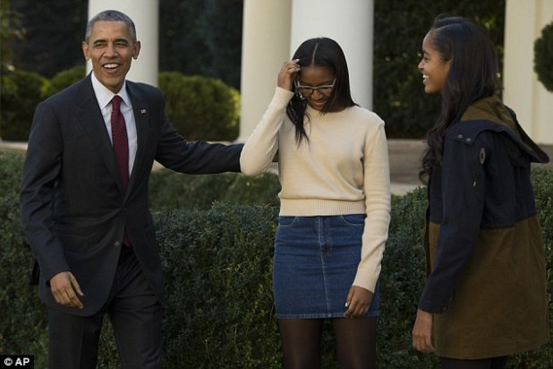 Leave the stage: The president escorted Sasha and Malia back inside after an upbeat performance