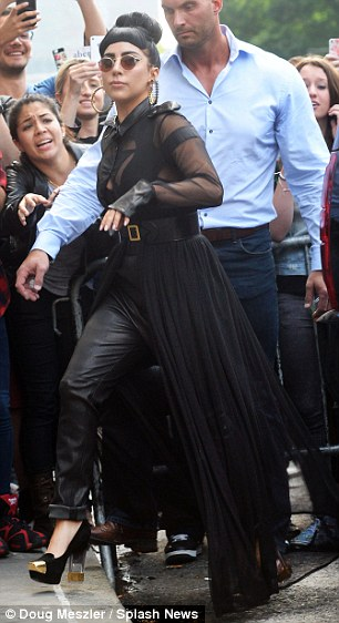 It's certainly not the first time Van Der Veen has been in the spotlight. He used to be Lady Gaga's bodyguard (pictured here with the star)