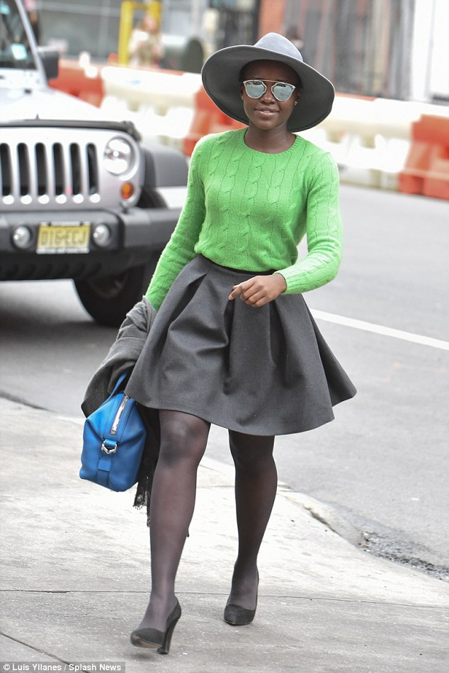 Lupita Nyongo showcases her shapely legs in green knit