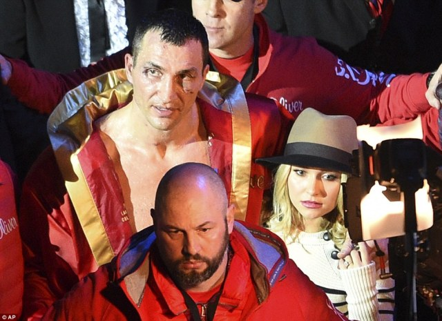 Klitschko looked distraught as he walked away from the fight with his American actress partner, Hayden Panettiere