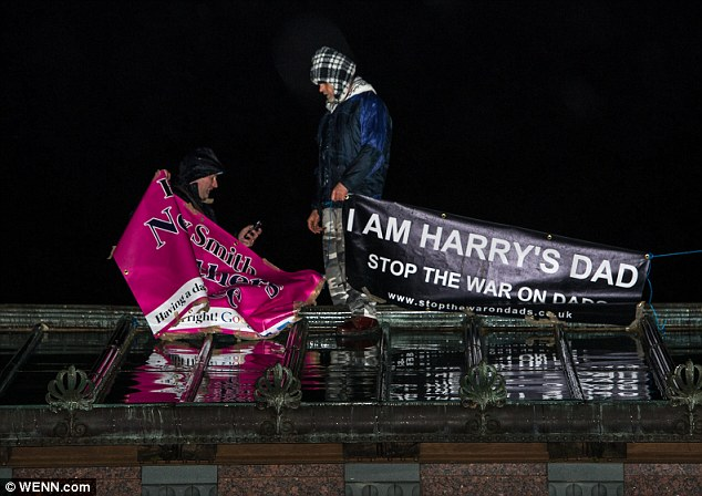 The two men, who stayed on the roof of the London landmark until 11pm last night (pictured), called for equal rights for fathers in divorce and separation proceedings and for a reform of the family courts proceedings