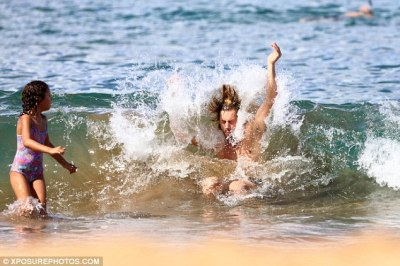 Watch and learn: The dad appeared to be performing his version of the backward bodysurf