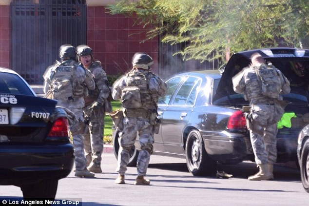 Members of a SWAT team are seen on the scene of a mass shooting in San Bernardino, California