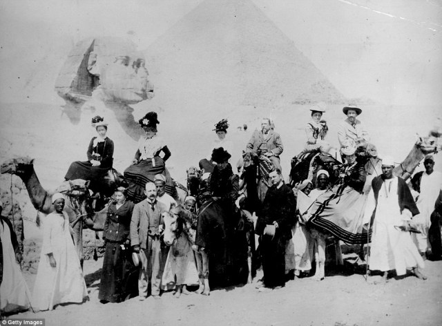 British tourists pose in front of the Sphinx in Giza, Egypt in fashionable clothing from the 1880s