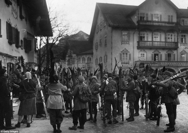 A group of tourists in Oberammergau waiting to go skiing in Bavaria. In 1928, skiing attire looked nothing like the uniforms of today