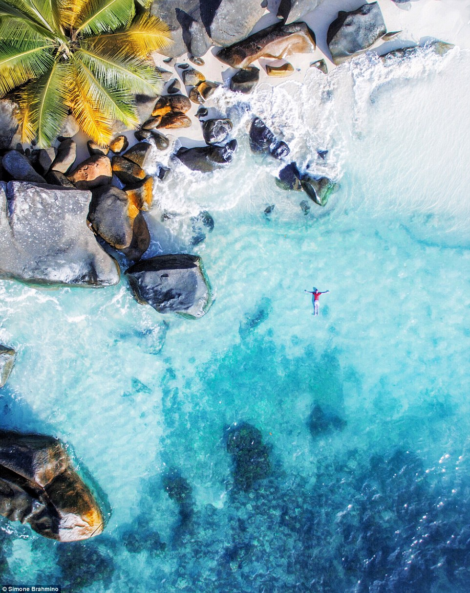The turquoise waters and golden sands of Seychelles looks dreamy when @brahmino's drone panned over it in the sky