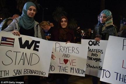 Muslims arrive at a candlelight vigil at the San Manuel Stadium in San Bernardino yesterday