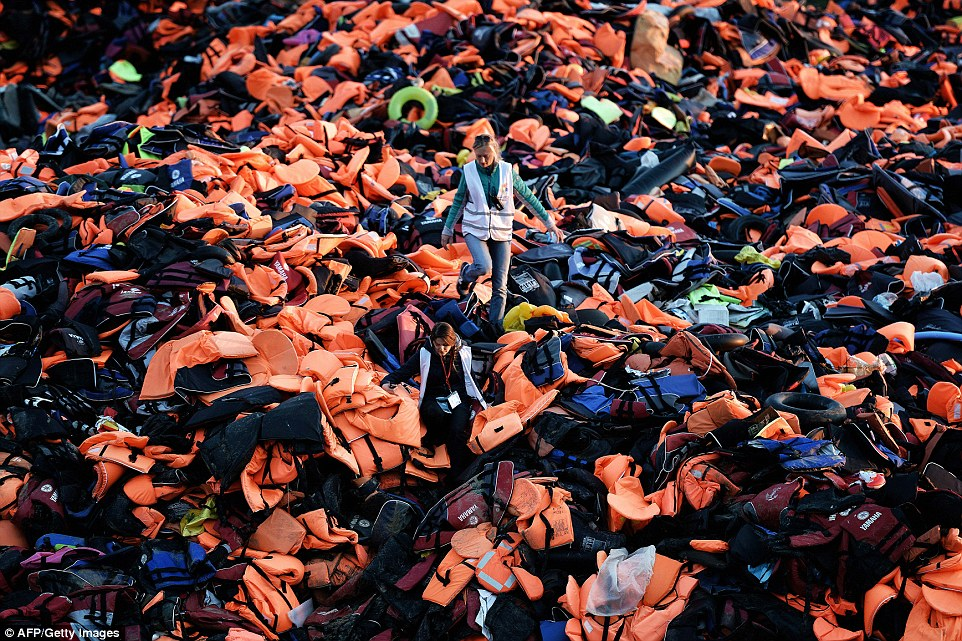 Each brightly coloured inflatable vest represents one of the 412,000 people who have arrived in Europe via Lesbos in the past six months