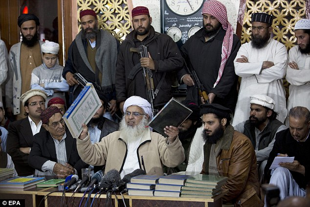 Officials have shared information about Malik's possible connection to the Red Mosque in Pakistan, where radical clericMaulana Abdul Aziz (pictured in 2014) used to preach