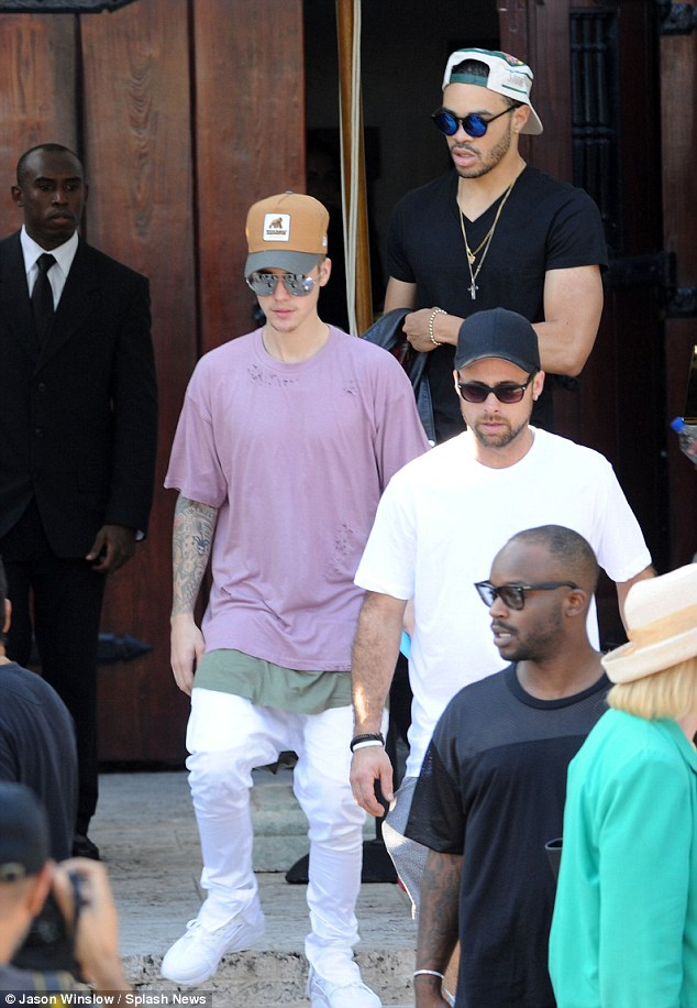 High roller: Justin rolled through South Beach with a typically large entourage as well as two Lamborghinis and a Ferrari