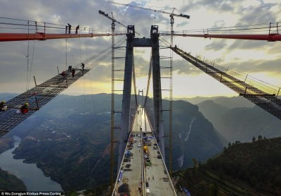 Construction: Workers are applying waterproof materials and asphalt to the Qingshui River Bridge which will open on Christmas Day