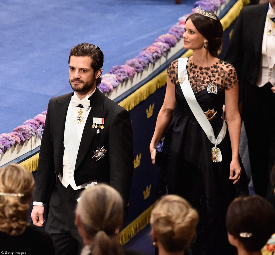 Prince Carl Philip of Sweden wore white tie and tails, while his wife who is pregnant wore a high-waisted full-skirted evening gown