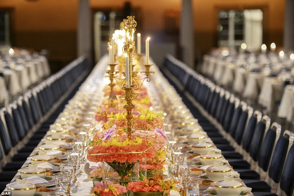 When the winners of the Nobel Prizes in literature and sciences received their prizes from King Carl at the Stockholm Concert Hall, they did so against a backdrop of flowers and gold candelabra cradling blazing white candles